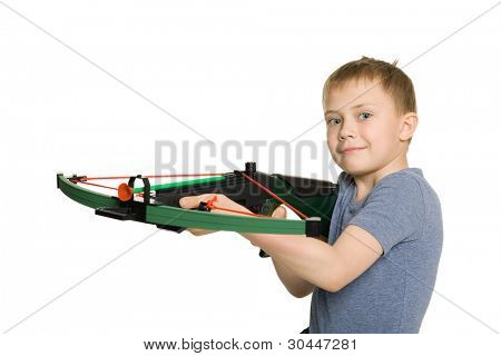 Smiling boy with the crossbow sport for children.