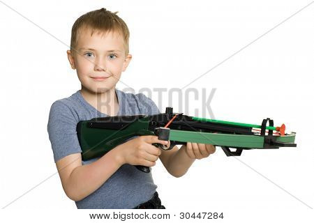 Smiling little boy with the crossbow sport for children.