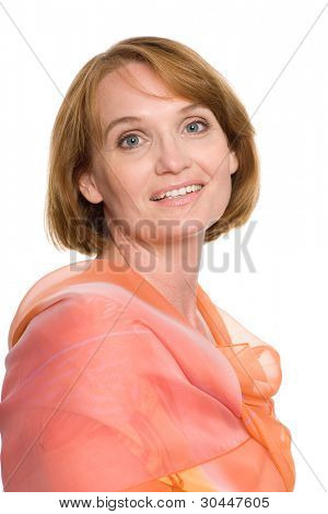 Portrait of a beautiful middle-aged woman with an orange scarf.