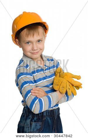 Joyful boy in the construction helmet and gloves.
