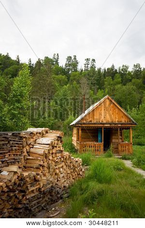 Wood house for leisure travelers in the forest. Stocked wood.