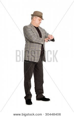 Elegant middle aged man waiting for checks his watch.