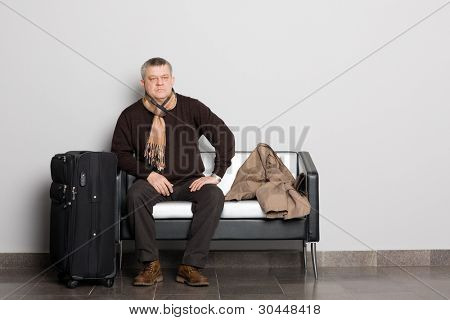 Thoughtful respectable middle-aged man in the waiting hall.