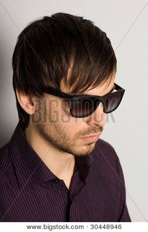 Fashionable young man in sunglasses
