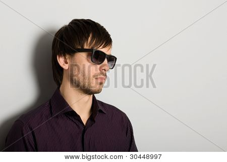 Stylish young man wearing sunglasses