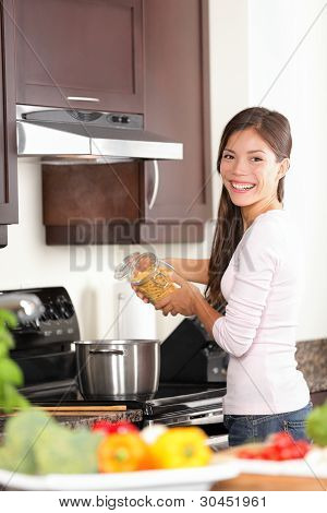 Woman In Kitchen Making Food