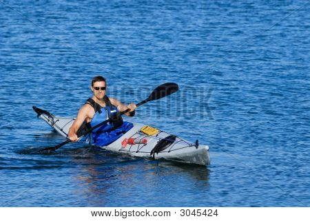 Athletic Man Showing Off In Sea Kayak
