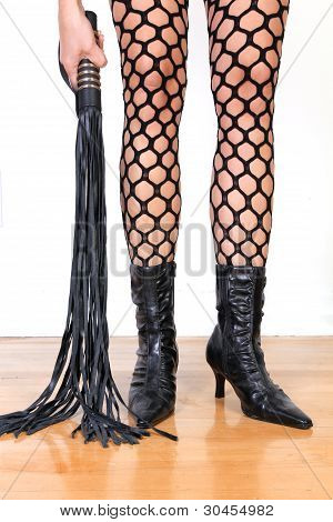 Legs And Leather Whip