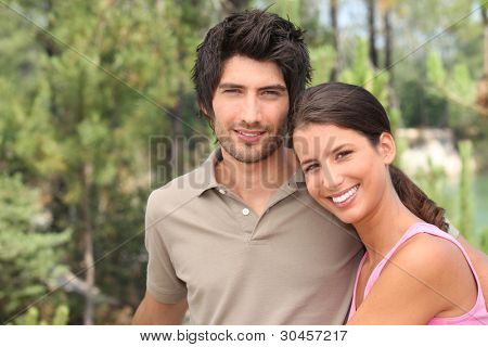 couple in pine forest near a lake