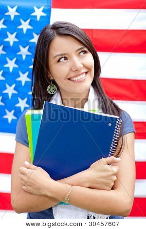 English female student with the American flag at the background