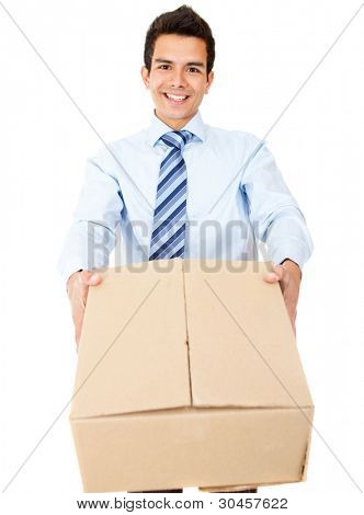 Business man delivering a package and smiling - isolated over a white background