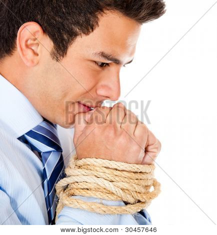 Tortured businessman holding his hands tied with a rope - isolated over white