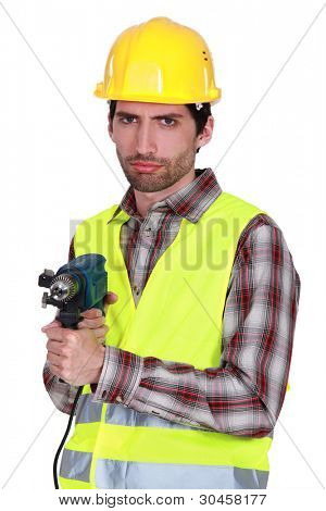 Portrait of a frowning tradesman