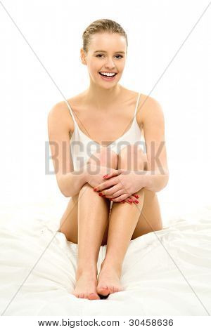 Young Woman in Underwear Sitting on Bed