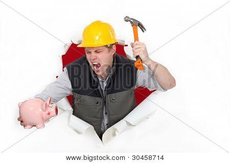Tradesman about to smash a piggy bank