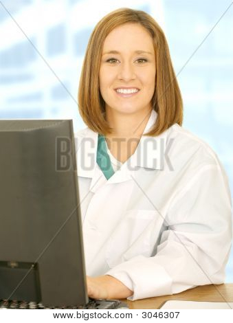 Smiling Medical Staff Working With Computer