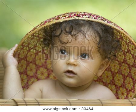 Infant Playing With Hat 3