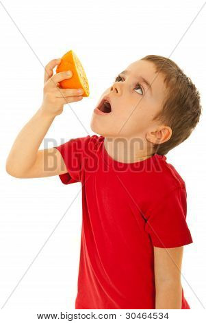 Boy Squeeze Orange To His Mouth