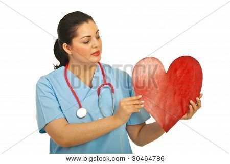 Doctor Woman Holding Heart Shape