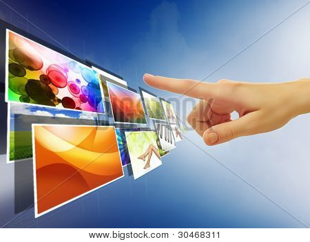 Hand Reaching Images Streaming From The Deep Over Sky Blue Background