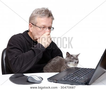 A middle aged caucasian man deeply thinking while looking at his laptop computer. Man is wearing casual black sweater with his cat nearby and his hand on his chin. Isolated on white background.