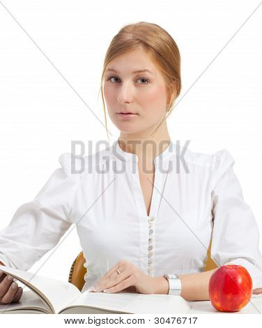 woman with apple and book