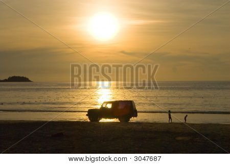 Car At The Sunset