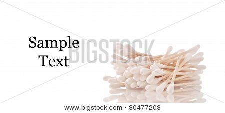 Cotton Swabs Against White Background With Space For Text