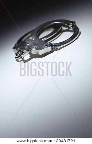 Abstract Pair of Handcuffs Under Spot Light With Room For Your Own Text.
