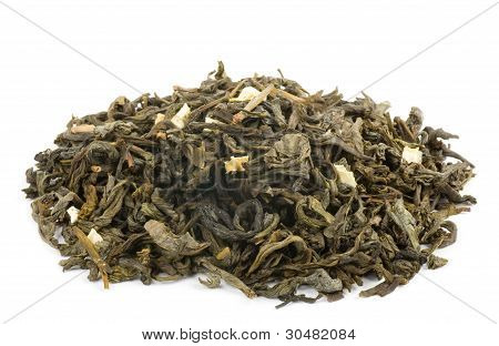 Green tea with slices of exotic fruit isolated