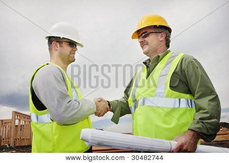 Two Construction Professionals Shaking Hands at the jobsite