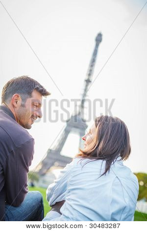 Young romantic couple sitting in Paris