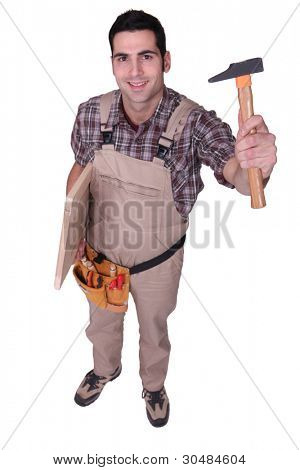 Tradesman holding up a tool