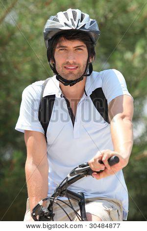 25 years old man doing mountain bike
