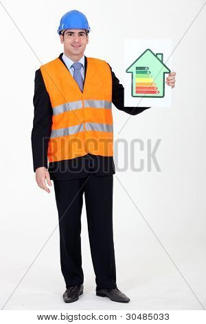 Engineer holding up an energy efficiency rating chart