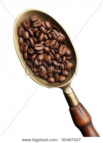 brass scoop with whole coffee beans on a white background