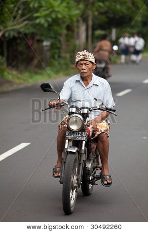 Old Balinese On Motorcycle