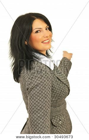 Happy Business Woman Pointing Back