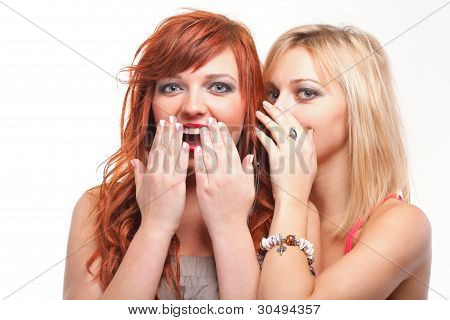 Society Gossip - Two Happy Young Girlfriends Talking White Background