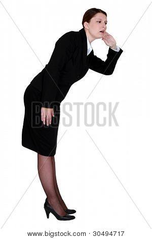 A hard hearing businesswoman.