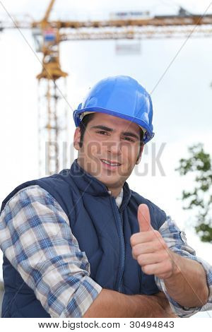 A construction worker giving the thumb up.