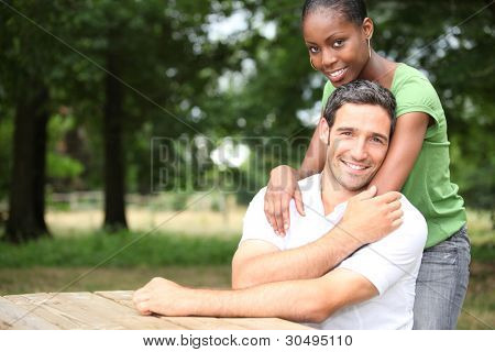 Racially mixed couple in the forest