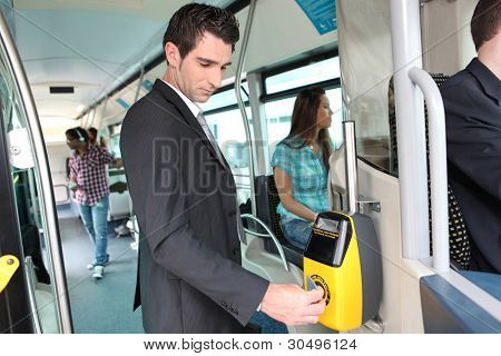 Businessman validating travel card