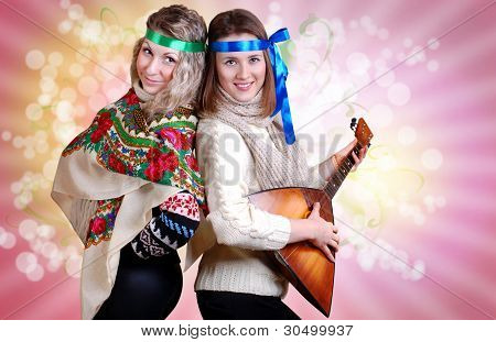Two Russian Beauty Girls With Folk Attributes