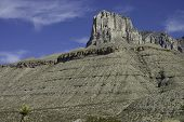 stock photo of stagecoach  - massive limestone formation of El Capitan in Guadalupe Mountains National Parks Texas USA - JPG