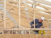 stock photo of gable-roof  - Carpenter framing gable end - JPG