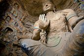 stock photo of grotto  - Huge buddha statues at Yungang grottoes which is one of the largest  - JPG
