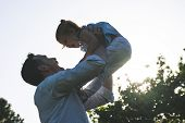 Divorced Father Playing With His Daughter Outdoors. poster