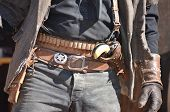 stock photo of gunfights  - wild west cowboy with holster and revolver - JPG