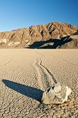 Moving rock in Death Valley Racetrack poster